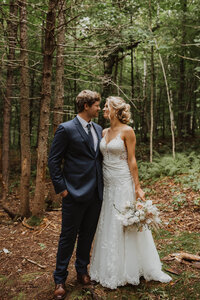 Couple embracing in the woods