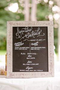 Drinks menu at the bar during an outdoor tent wedding held at Elsie Perrin Williams Estate