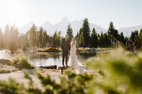 couples portraits after grand teton national park wedding at schwabacher landing at sunset