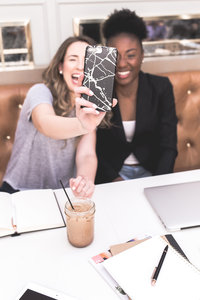 stock photo - two women laughing iphone