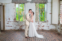 bride and grrom in atalaya castle in huntington beach state park