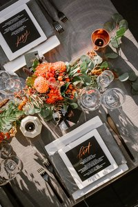 Modern gray black white and orange table scape with copper rose gold details
