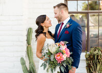 Bride and groom on their wedding day at the historic Cree Estate in Palm Springs, California. Wedding photo taken by Cheers Babe Photo.