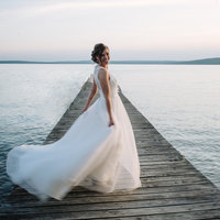 Bride Twirling Dress in Minnesota Lake