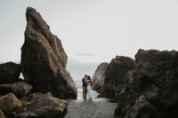 Couple amongst the rocks on Ruby Beach by Sarah Anne Photo