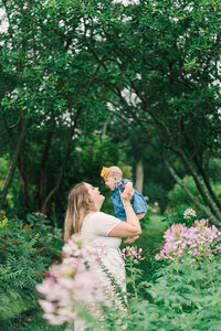 mother and baby outdoor family session with flowers