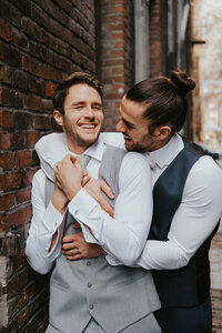 Adorable gay couple in downtown Seattle by Sarah Anne Photography