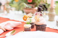 Wedding reception table scape with decorative cupcakes