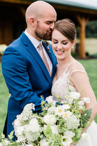 Portrait of newlywed couple at the beautiful middle fork barn in abingdon virginia