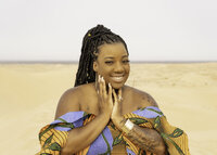 Black woman with twists and African print clothing