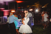 Bride and groom share an embrace at their backyard wedding in Denver Colorado