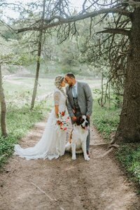 Bride and Groom walking with their dog in knoxville Tn