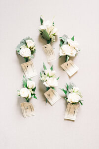 White and greenery corsages at Ashford Estate wedding captured by best Wedding Photography NJ Myra Roman Photography