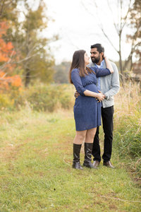 couple standing and looking at one another  on a farm in the fall