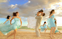 waikiki-wedding-photography-girls-dancing-on-beach-wearing-blue-dress