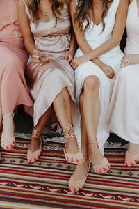 Bridesmaids in blush and nude dresses
