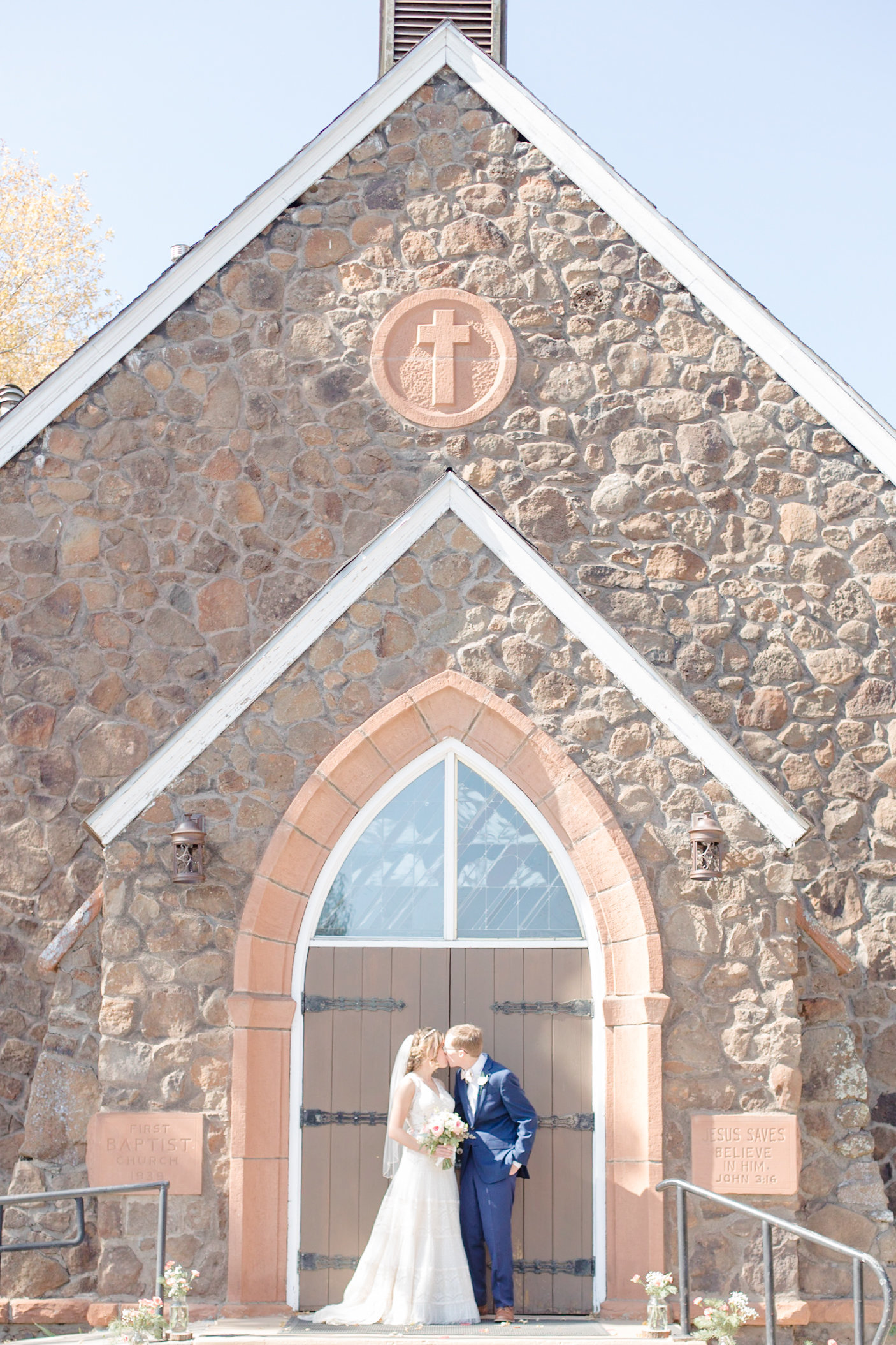 Couple stands in front of their church after their Flagstaff wedding