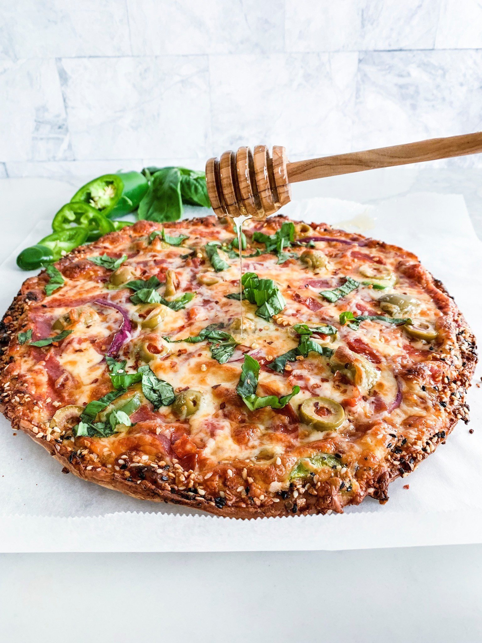 Spicy salami & olive pizza