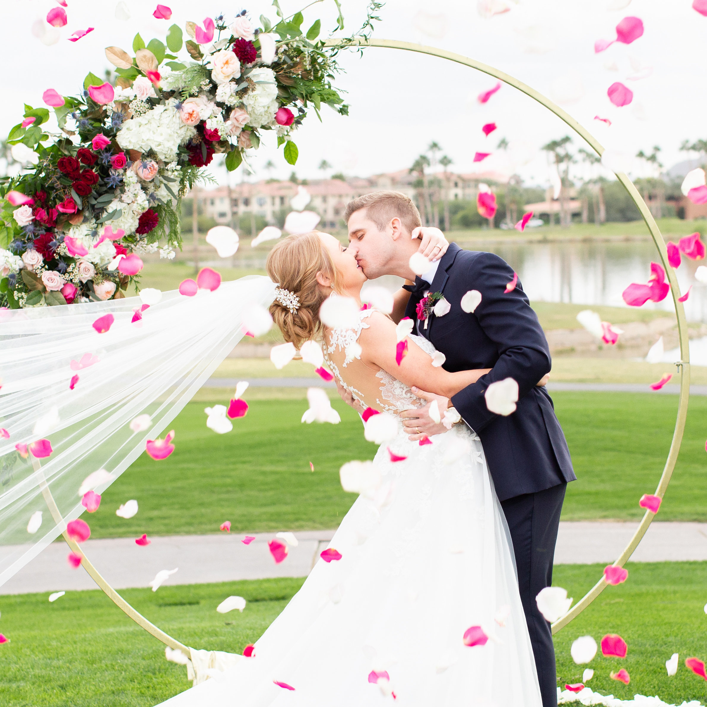 bride and groom kiss flower petals