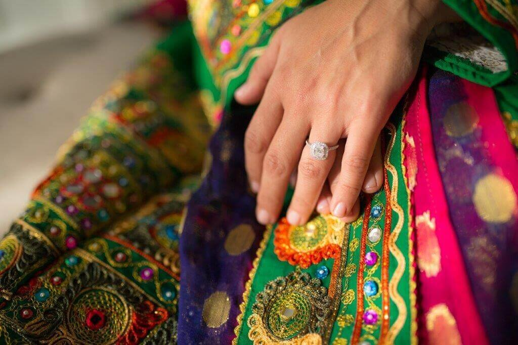 Philippe Studio Pro tries to be the best sacramento wedding photographer they can, capturing the details of an engagement ring up against traditional Afghan wedding clothing.