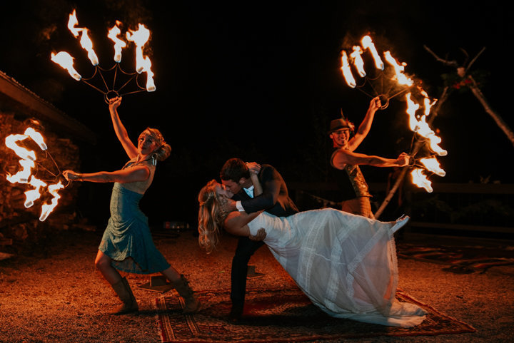 bride and groom kissing with fire, fire dancers at reception, marble wedding photographer, marble colorado elopement photographer, marble colorado wedding venues, fire dancers marble co wedding, adventure elopement photography, Marble Lodge on Beaver Lake Retreat Campus fire dancers bride groom exit colorado
