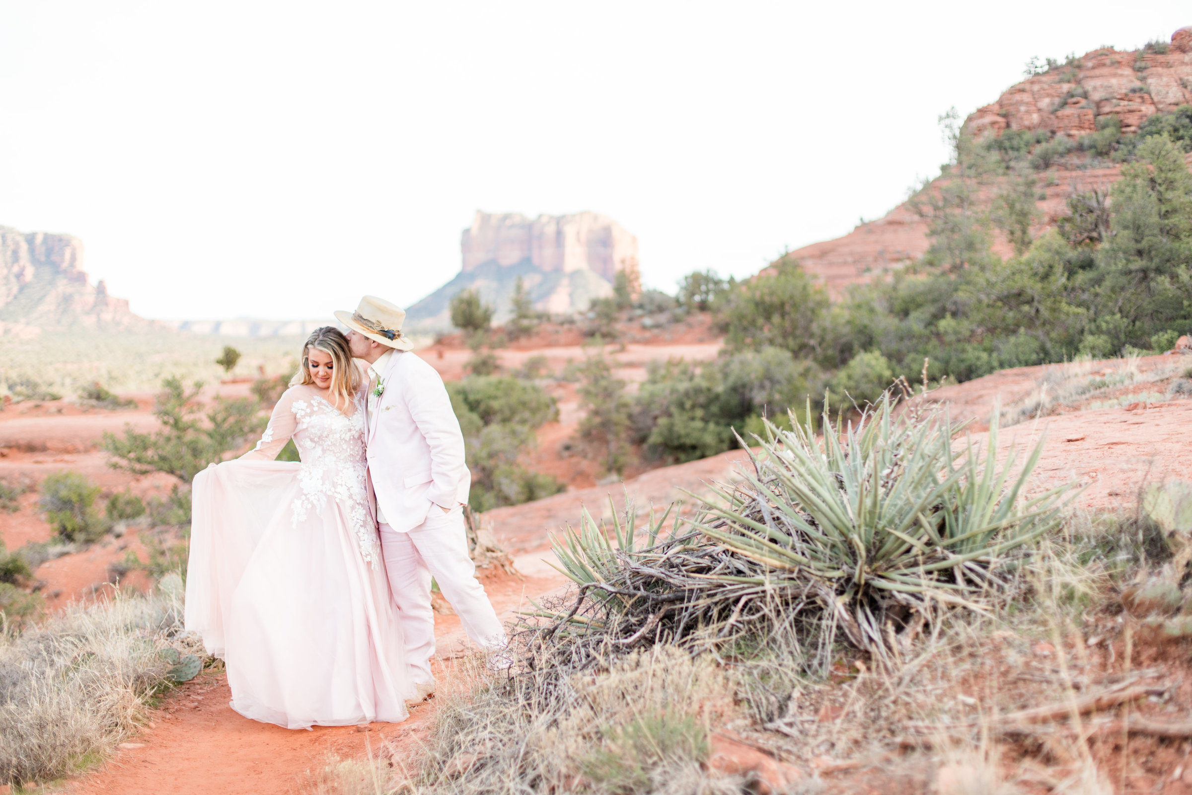 A bride fans her wedding dress during an elopement in Arizona