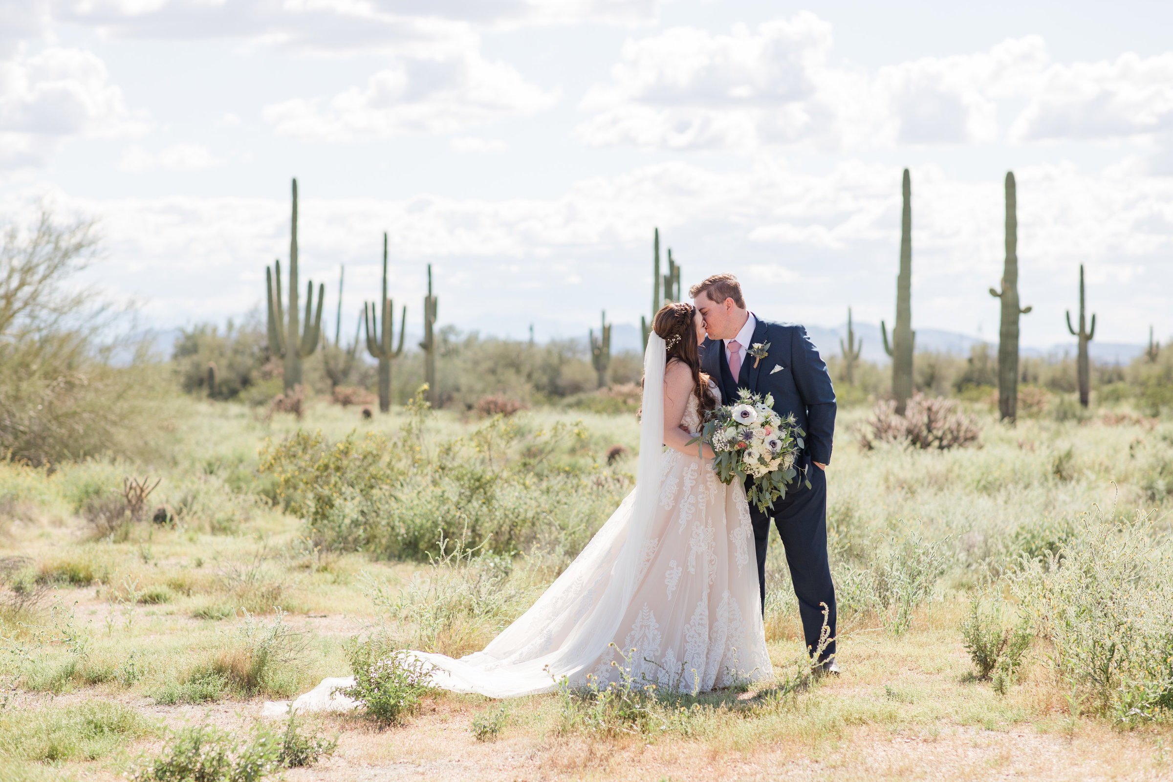 Photo of bride and groom at their desert wedding