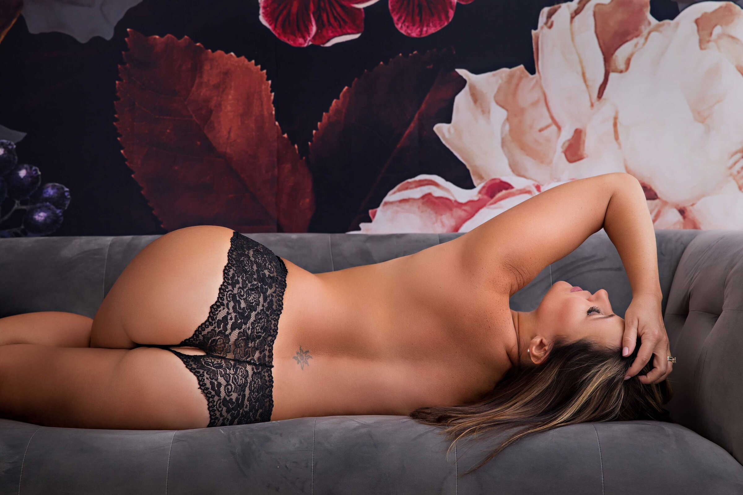 black lace panties on woman laying on couch