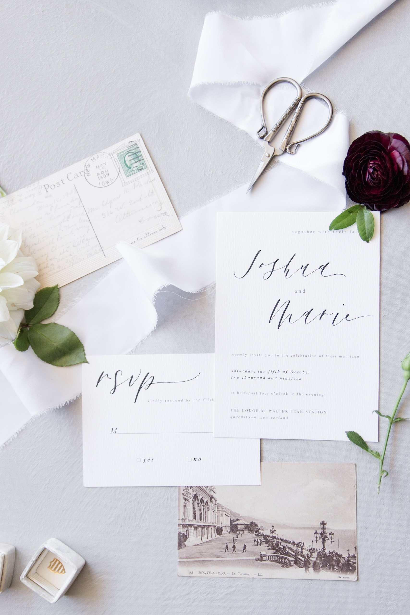 Collection of invitations with florals and ribbon