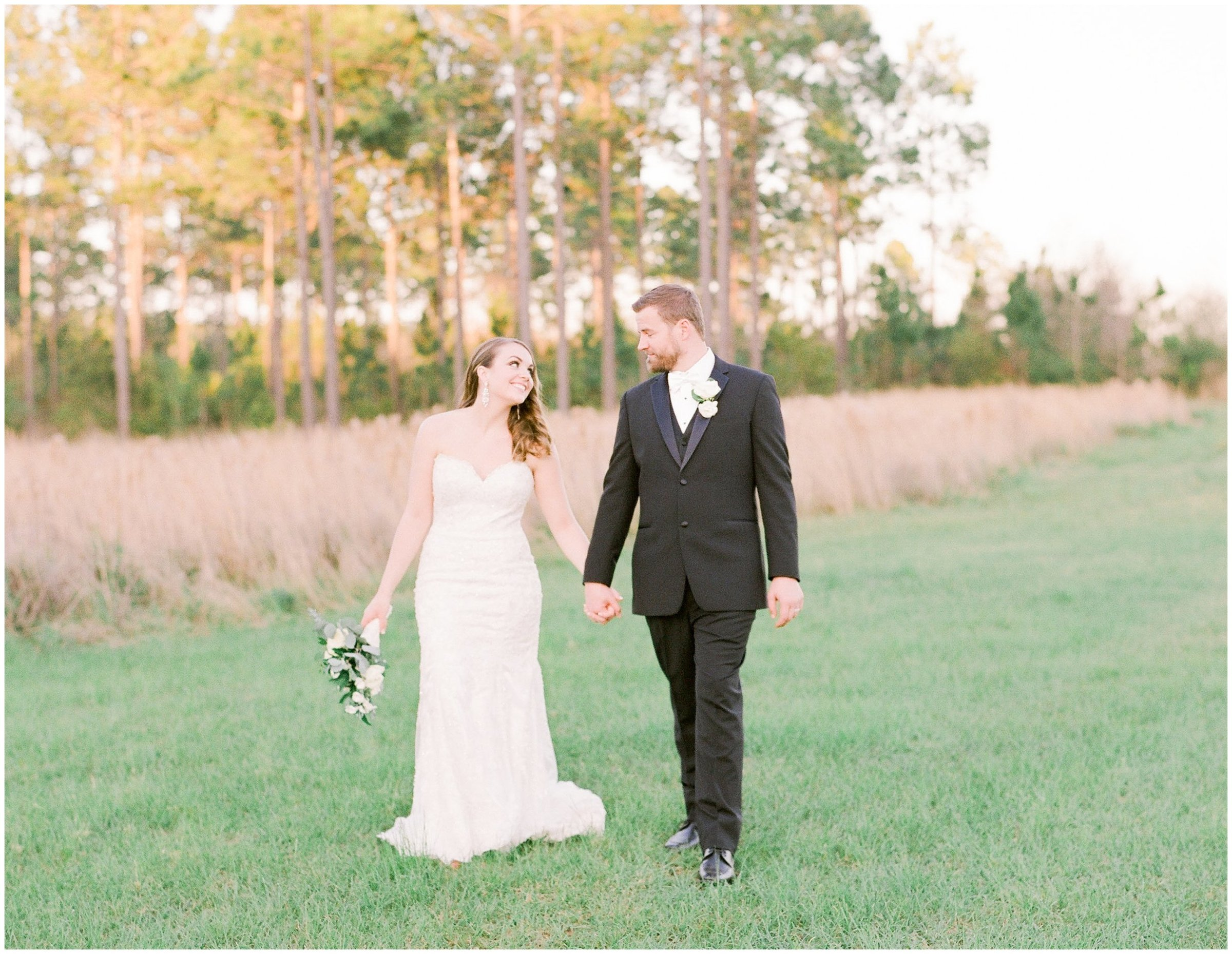 Bride and Groom walking around beautiful Rosie Creek Farms  after there warm spring wedding.