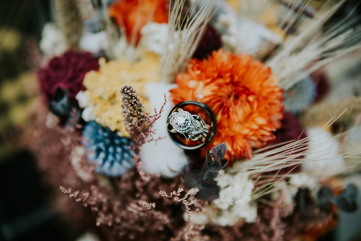 on the windfall north carolina wedding photographer, rustic bouquet, ring shot, rings on dried bouquet, salty spruce studio, wedding photographers, destination wedding photography, on the windfall, on the windfall wedding photographer, dried bouquet inspiration