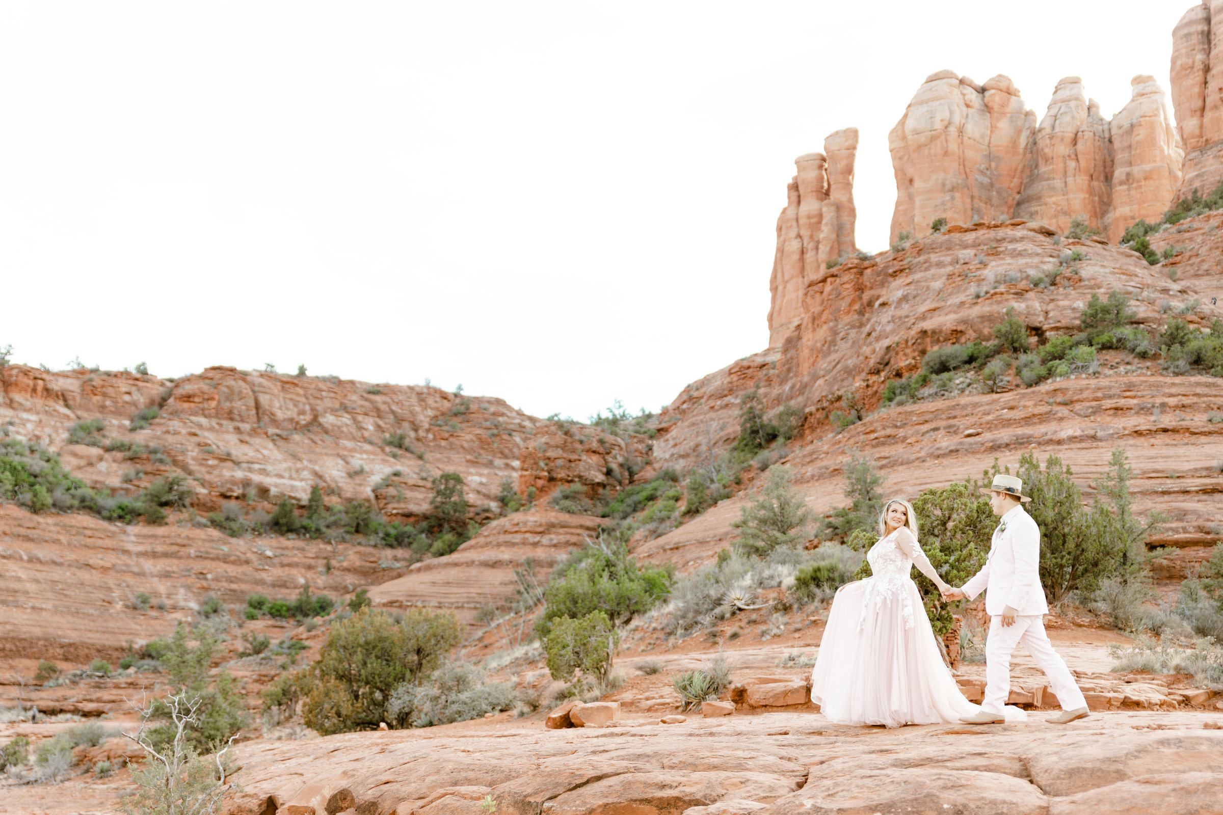 Bride and groom walking to their elopement in Sedona