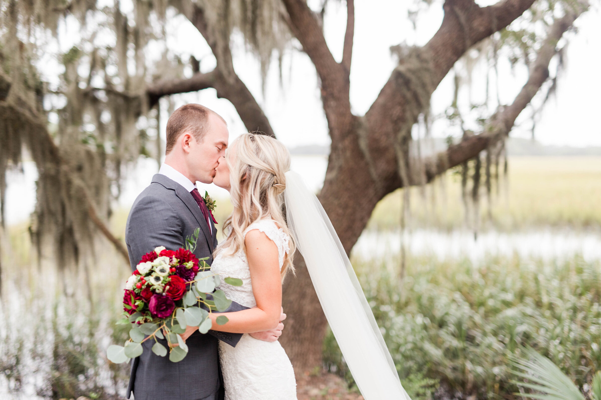 Bride and Groom kissing in front of spanish moss