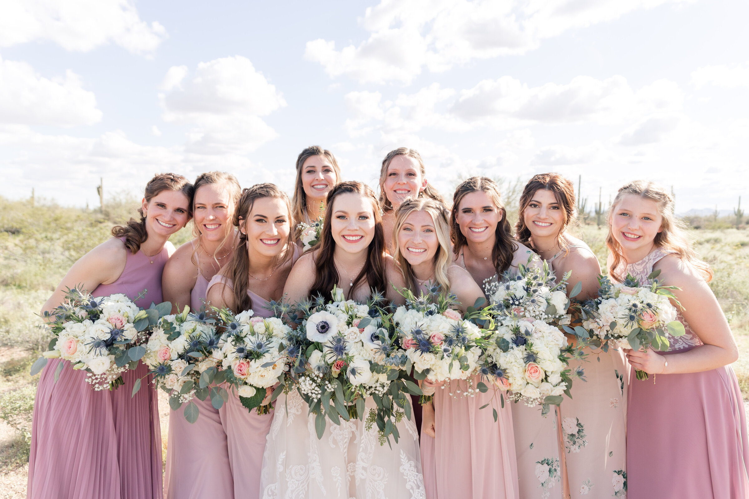 Group of bridesmaids huddled together for a picture