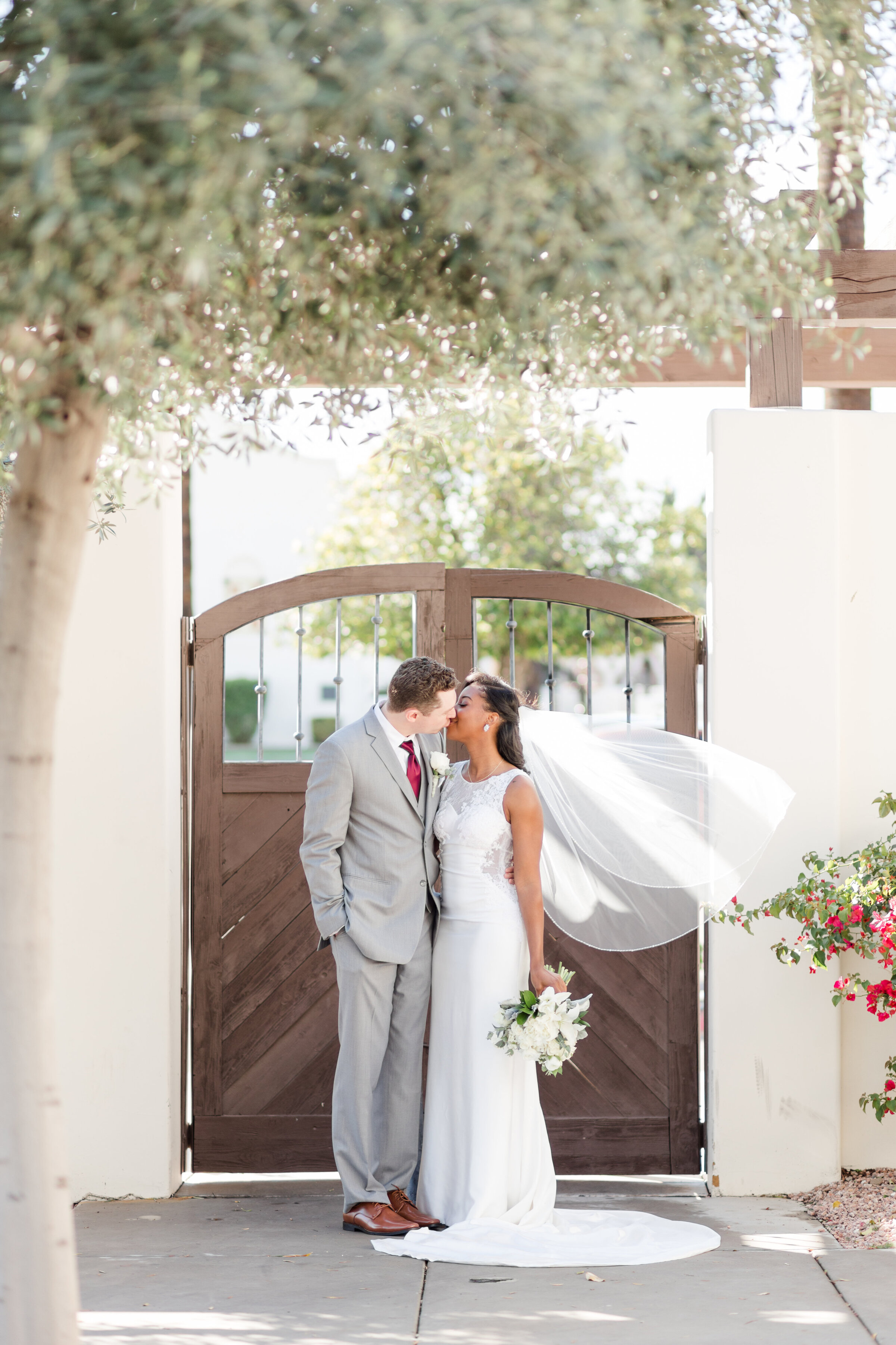 Bride and groom pose at their wedding venue in Peoria, Arizona