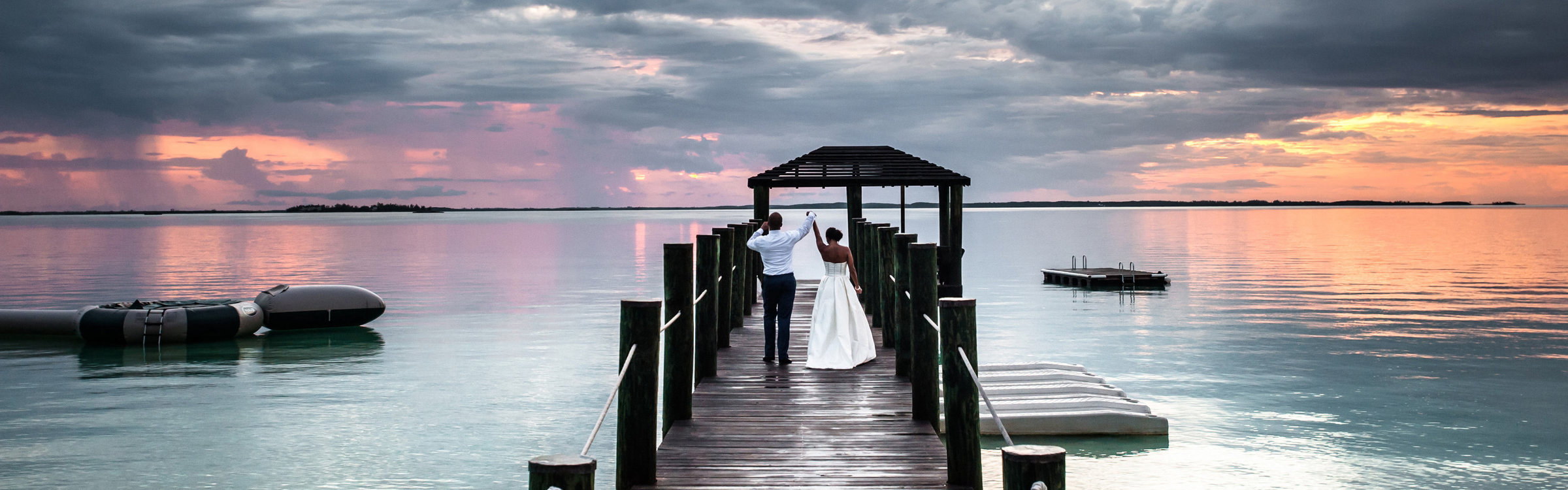 Destination-Wedding-Bride-and-Groom-on-Dock-Harbour-Island-Bahamas-copy