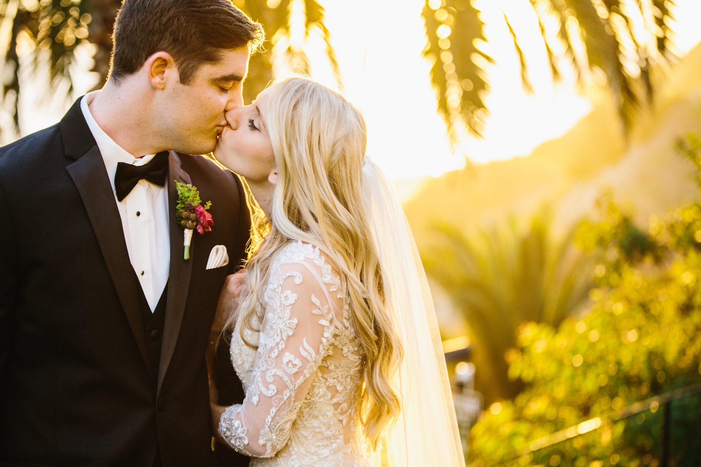 Bride and Groom Kissing in Warm Sunlight at Bel Air Bay Club