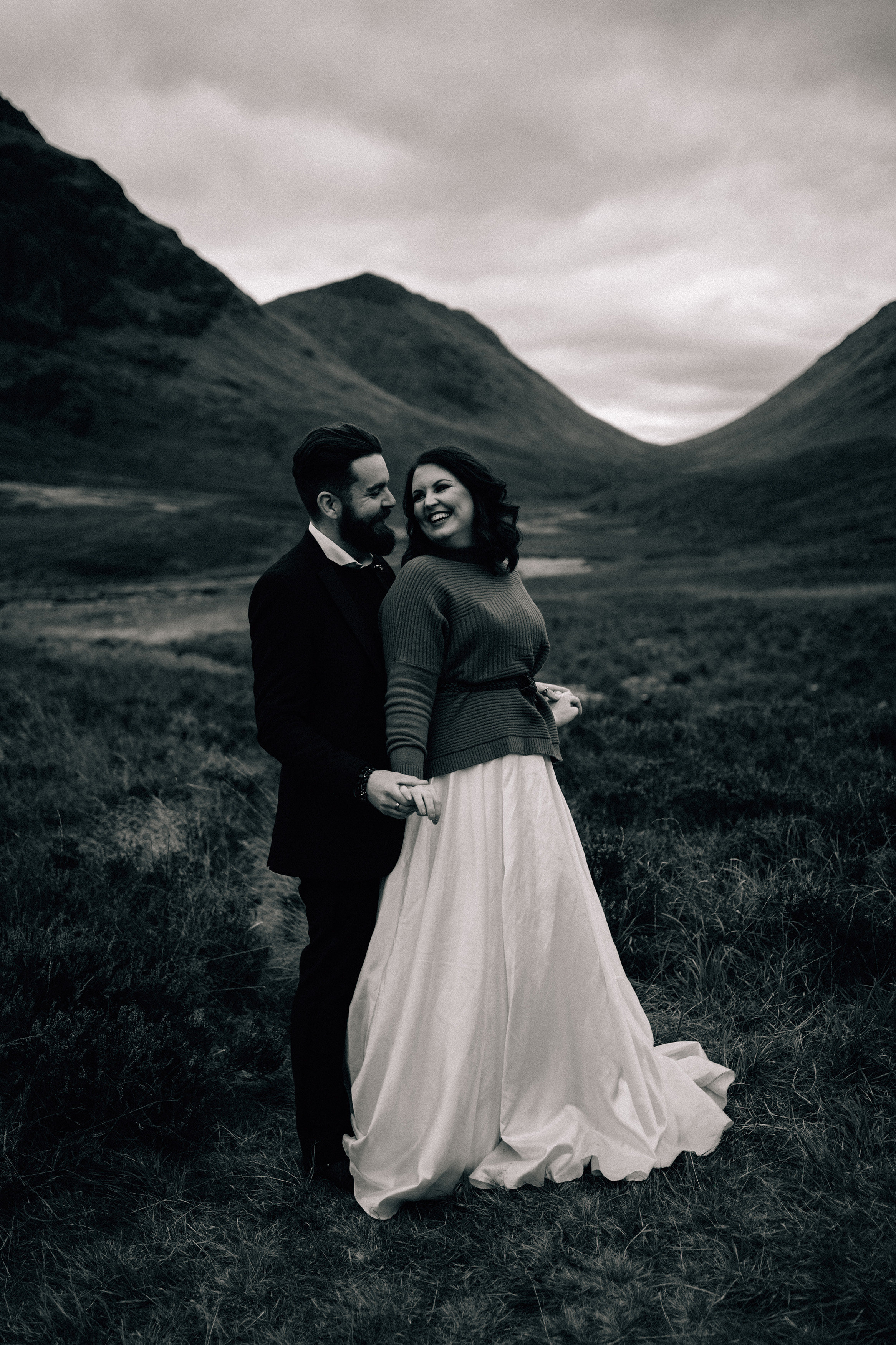 Scottish elopement couple smiling and holding hands