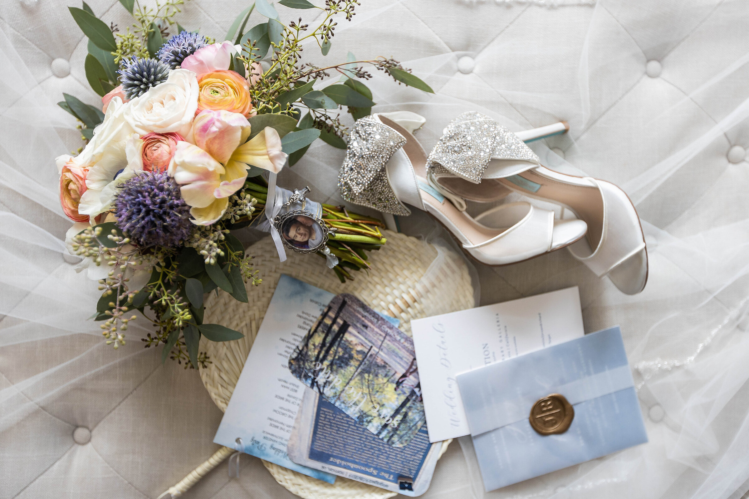 Flat lay of wedding details including shoes, invitations and flower bridal bouquet by sacramento wedding photographer, philippe studio pro