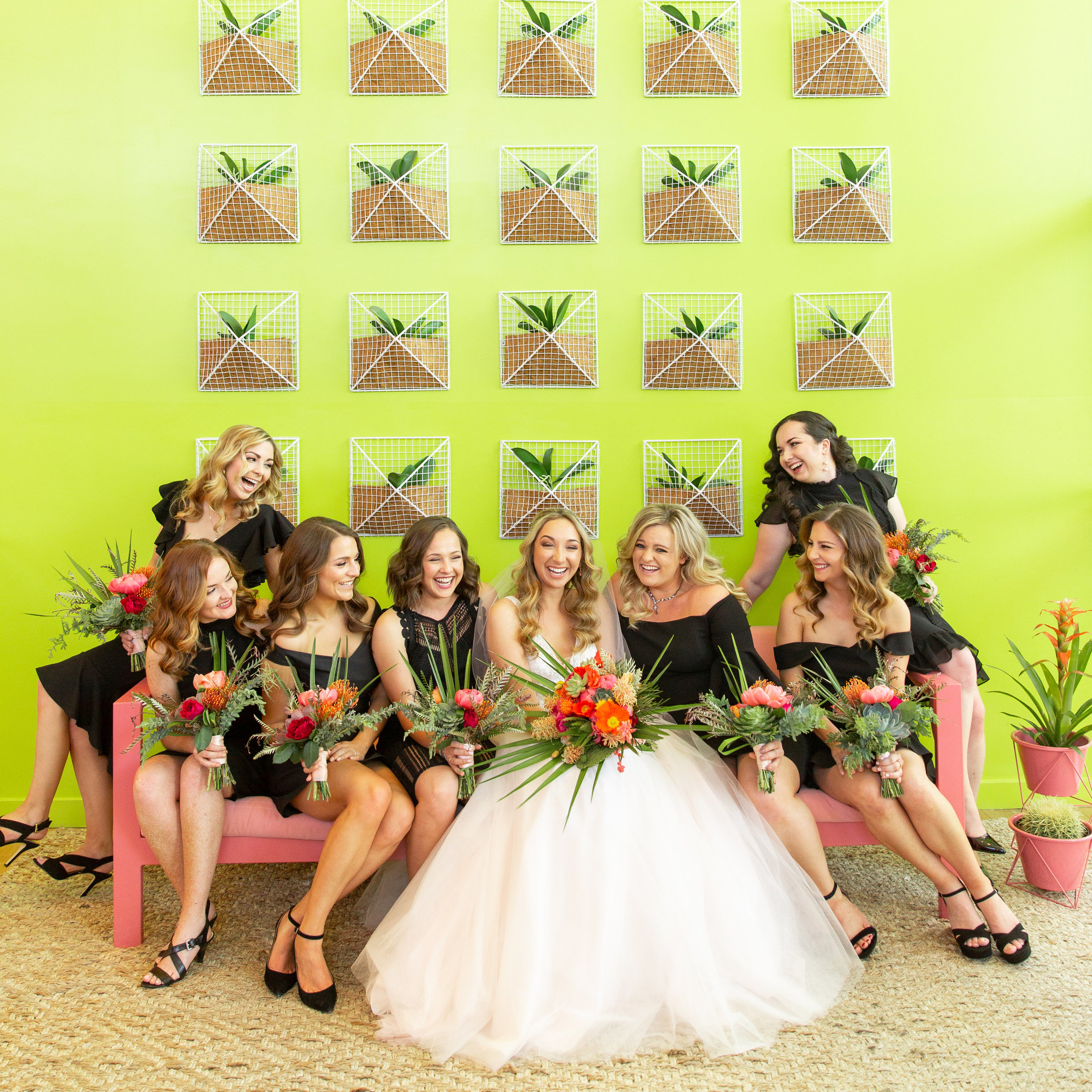 black bridesmaid dress colorful bouquet