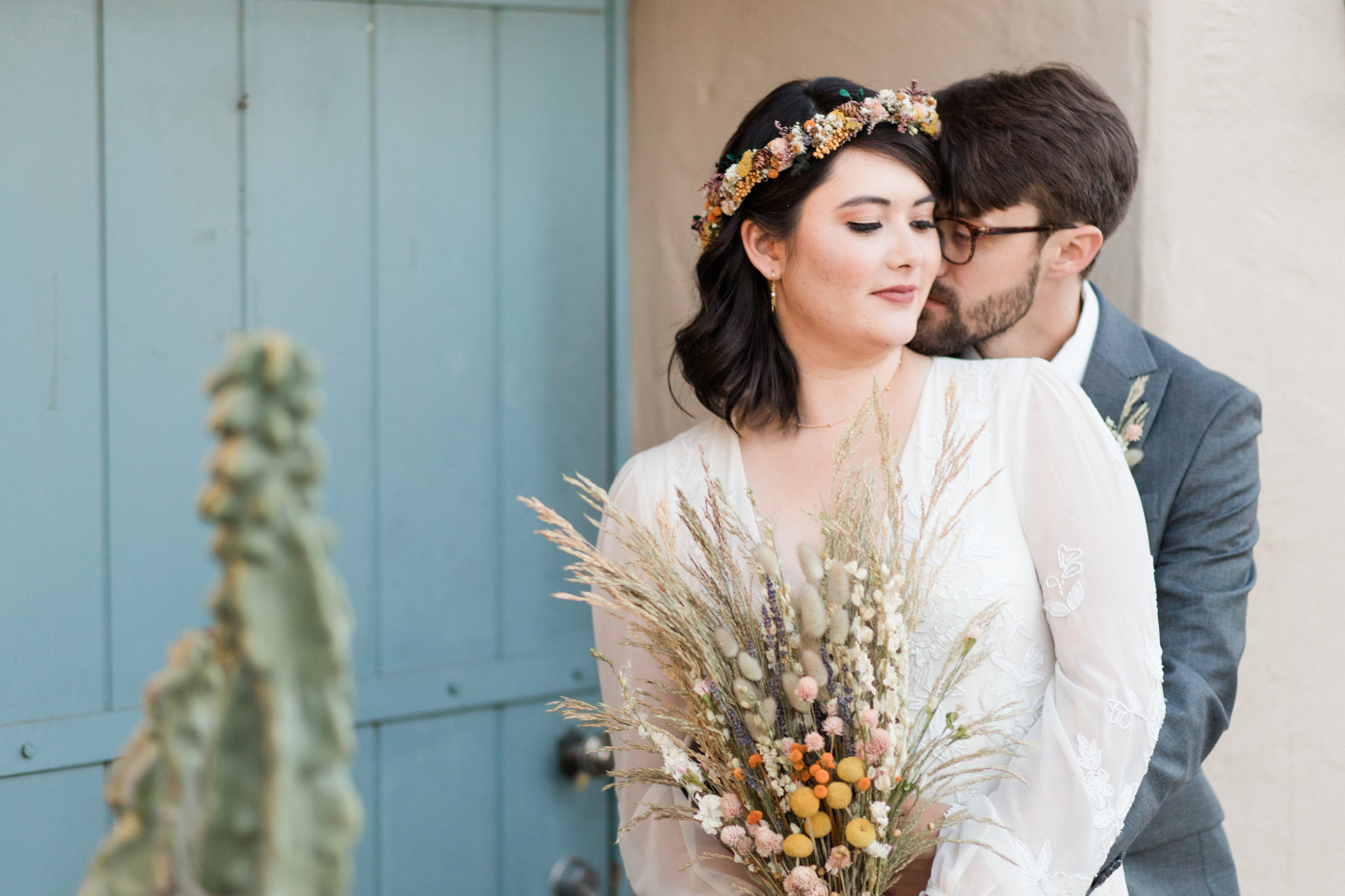 Bride and groom pose for photo at Desert Botanical Gardens