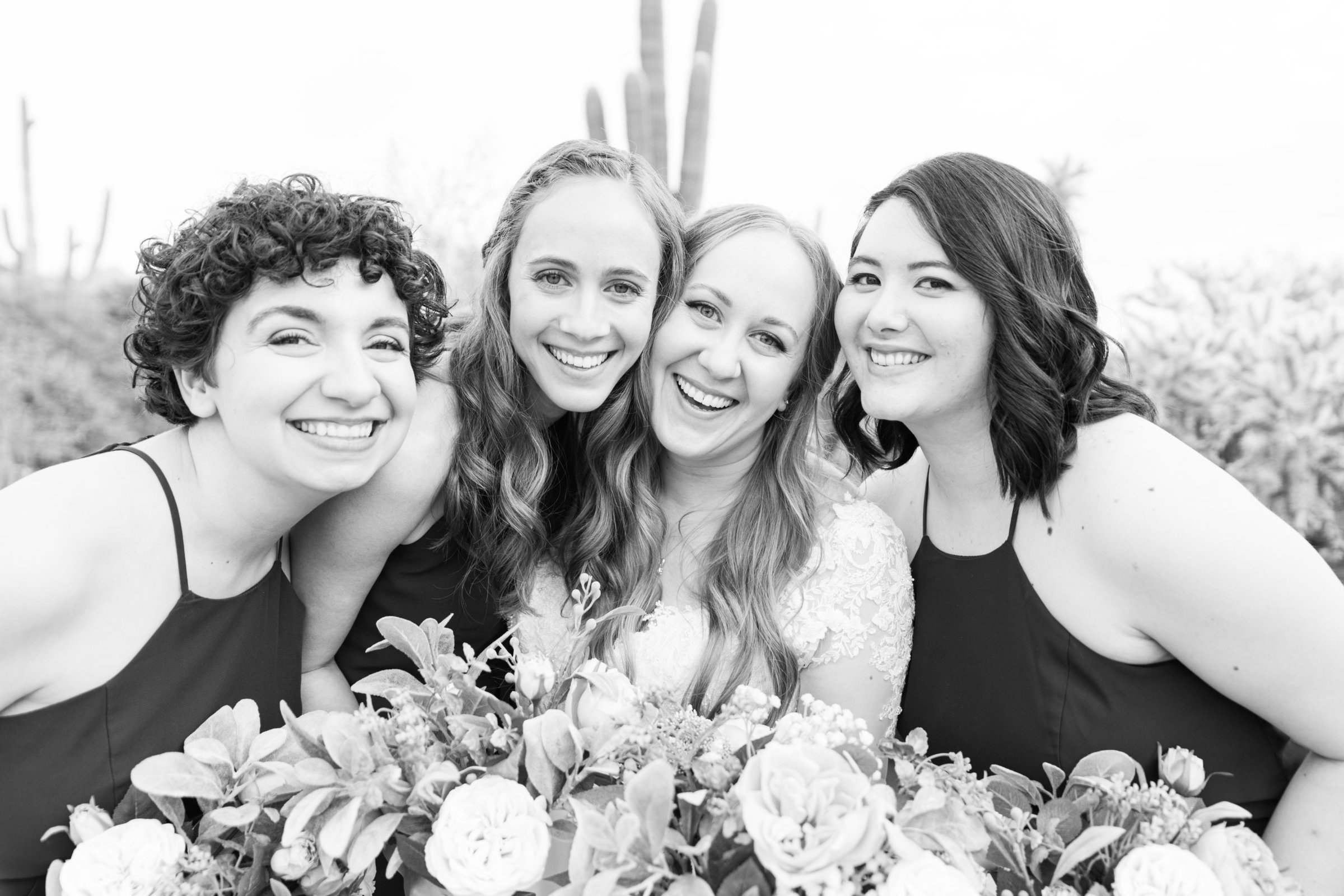 A group of bridesmaids pose for wedding photographer