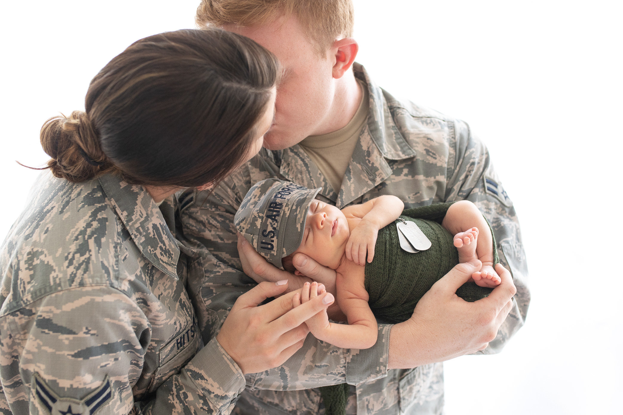 military newborn being held by army parents