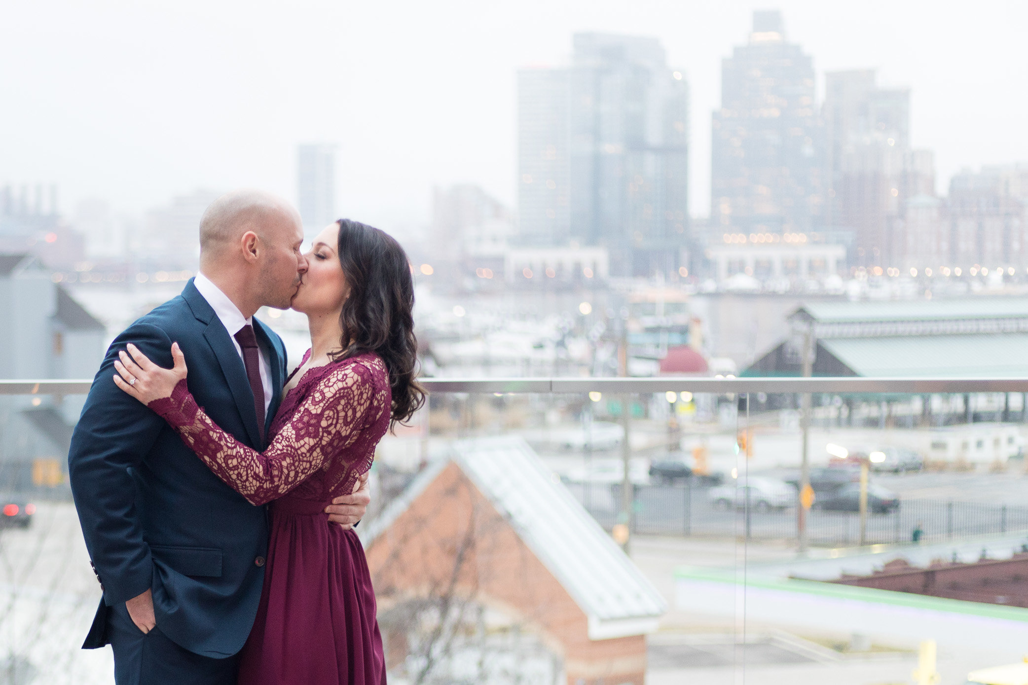 Man and woman kissing on Baltimore Skyline