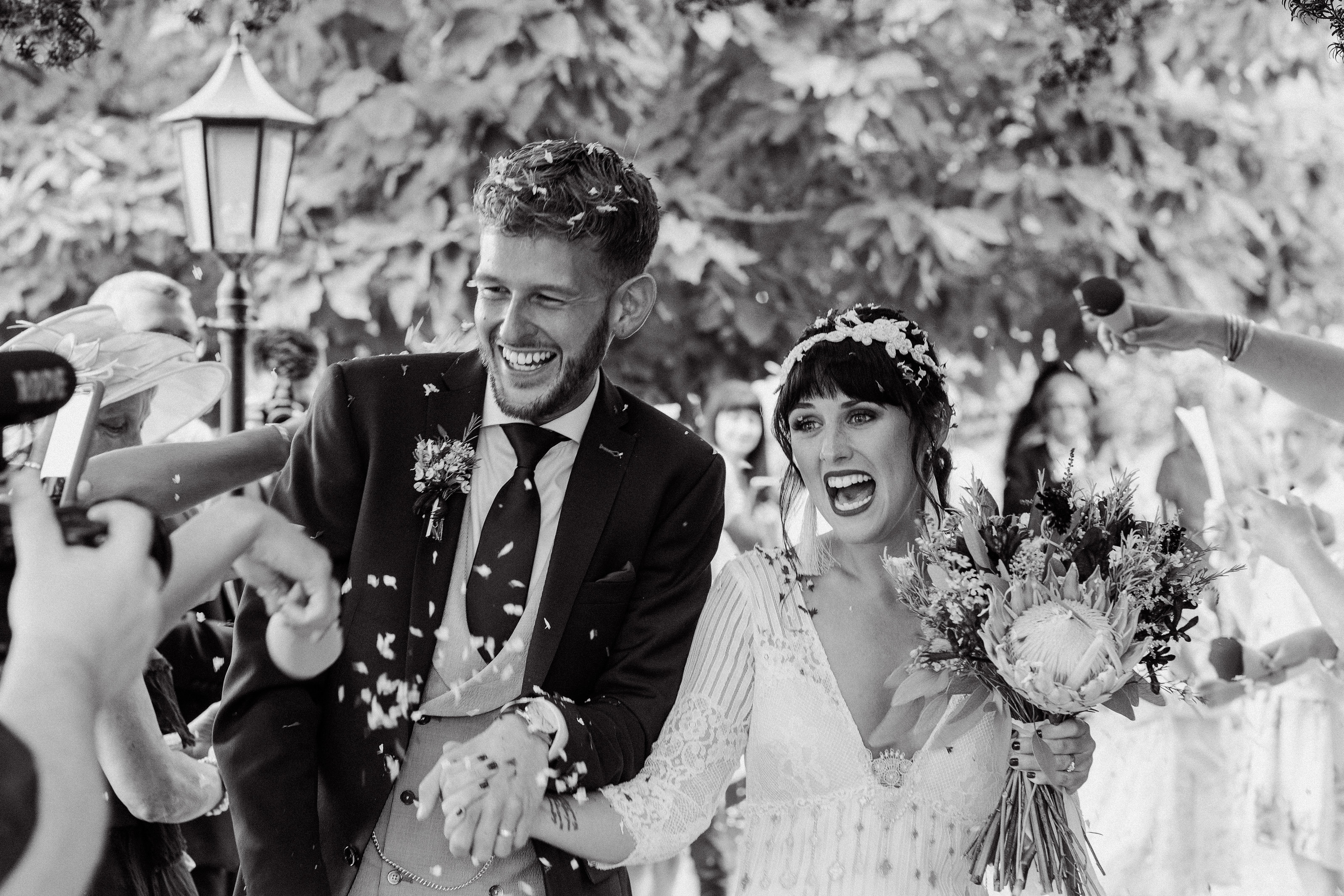Adorlee Photography captures a very excited bride and groom during a confetti throw