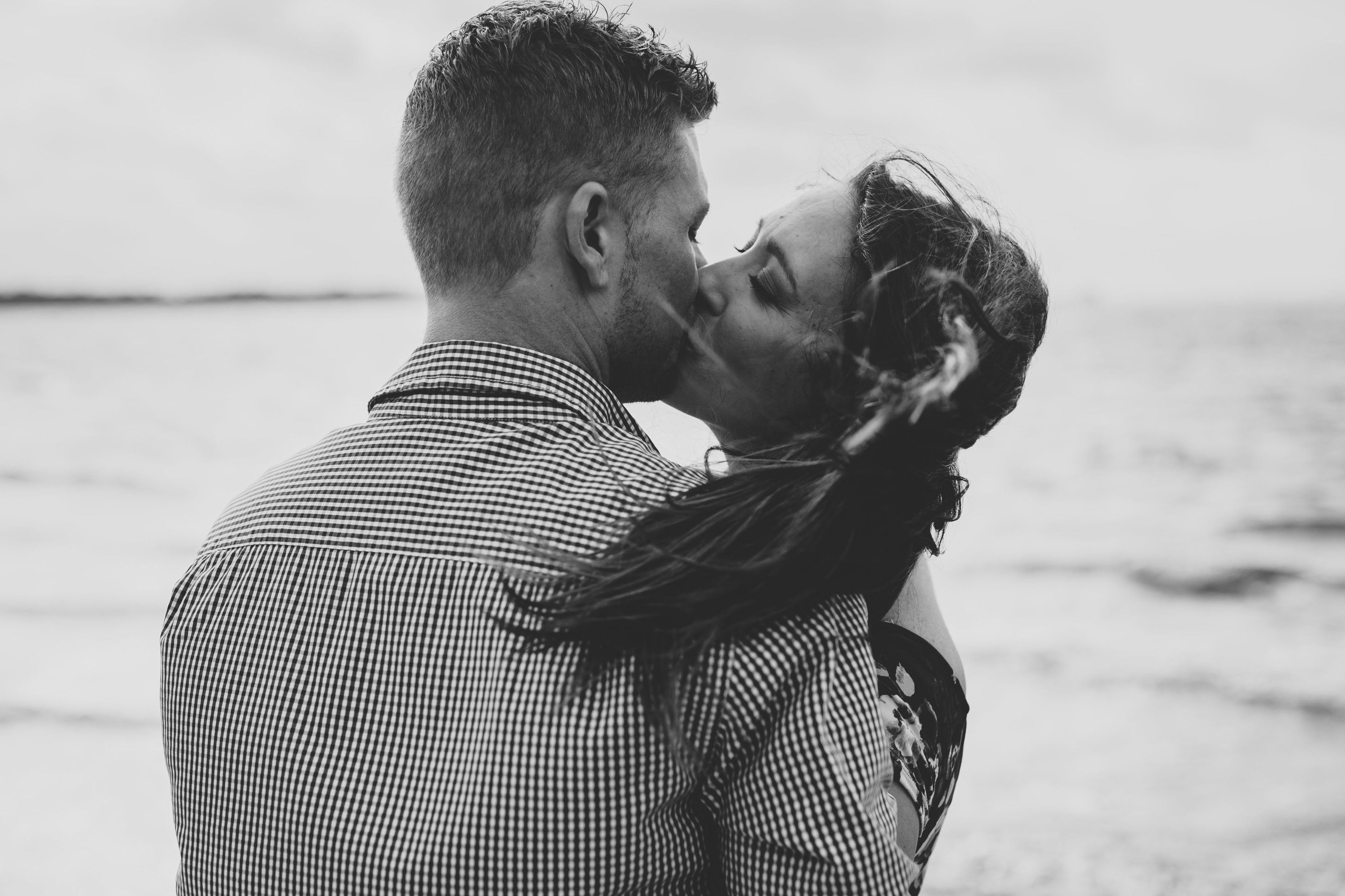 engagement session, couple kissing by the lake
