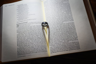 Wedding rings in Bible with Heart shadows at Mississippi Wedding