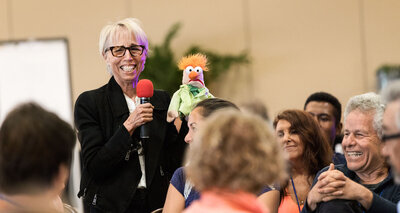 Geneen Roth with Beaker Puppet at Event