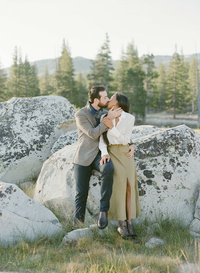 37-KTMerry-destination-engagement-couple-kissing-Yosemite