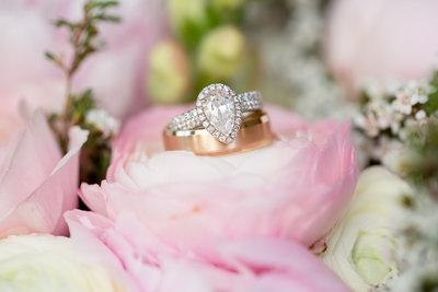 austin wedding photographer rings on flowers natural austin texas